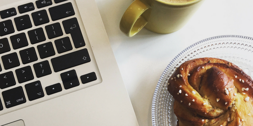 Laptop, coffee and pastry